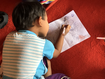 Child drawing in Myanmar