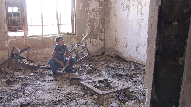 Noeh sat in his destroyed bedroom