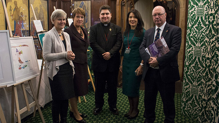 Lisa Pearce and Father Daniel in Parliament