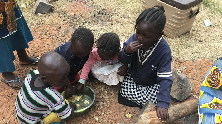 Children eat of the food we distributed